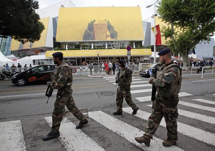 French soldiers patrol in front of the Festival Palace before the opening of the 69th Cannes Film Festival in Cannes, France, May 11, 2016.  REUTERS/Jean-Paul Pelissier