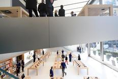 Workers staff a new Apple retail store during a media preview in San Francisco, California, U.S., May 19, 2016. REUTERS/Noah Berger