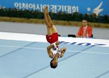 South Korea's Yang Hak-seon competes in the men's floor exercise final of the artistic gymnastics competition during the 17th Asian Games in Incheon September 24, 2014. REUTERS/Issei Kato