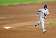 May 12, 2016; Bronx, NY, USA; Kansas City Royals left fielder Alex Gordon (4) rounds the bases on his home run during the fourth inning against the New York Yankees at Yankee Stadium. Mandatory Credit: Anthony Gruppuso-USA TODAY Sports