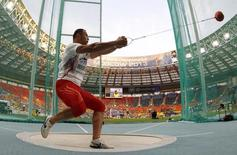 Koji Murofushi of Japan competes in the men's hammer throw final during the IAAF World Athletics Championships at the Luzhniki stadium in Moscow August 12, 2013. REUTERS/Dominic Ebenbichler