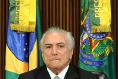 Presidente interino, Michel Temer, durante apresentação de medidas econômicas a líderes do Congresso. 24/05/2016. REUTERS/Adriano Machado