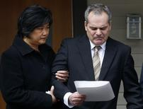Police inspector Doug de Grood pauses with his wife Susan while making a statement to the press in Calgary, Alberta, April 17, 2014.  REUTERS/Todd Korol