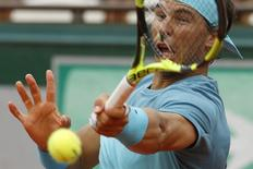 Nadal returns the ball. REUTERS/Pascal Rossignol