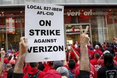 People demonstrate outside a Verizon wireless store during a strike in New York, U.S., April 18, 2016. REUTERS/Shannon Stapleton