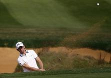 Gregory Bourdy of France hits out of a sand trap on the 7th hole during the BMW Masters 2013 golf tournament at Lake Malaren Golf Club in Shanghai October 26, 2013. REUTERS/Carlos Barria