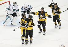 May 30, 2016; Pittsburgh, PA, USA;  Pittsburgh Penguins center Nick Bonino (13) celebrates with teammates after scoring a goal past San Jose Sharks goalie Martin Jones (31) in the third period game one of the 2016 Stanley Cup Final at Consol Energy Center. Mandatory Credit: Charles LeClaire-USA TODAY Sports