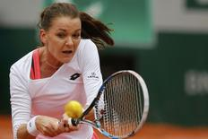 Agnieszka Radwanska returns the ball during her match against Tsvetana Pironkova at the French Open, May 31, 2016.  REUTERS/Pascal Rossignol