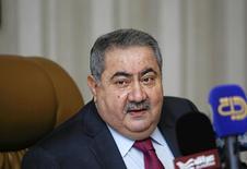Хошияр Зебари на пресс-конференции в Багдаде. Ирак надеется продать евробонды на сумму $2 миллиарда в последний квартал года, когда начнёт поступать международная помощь, что будет способствовать снижению стоимости заимствований, сказал министр финансов Ирака Хошияр Зебари. REUTERS/Khalid al-Mousily