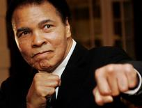Muhammad Ali poses at the 2006 World Economic Forum in Davos. REUTERS/Andreas Meier