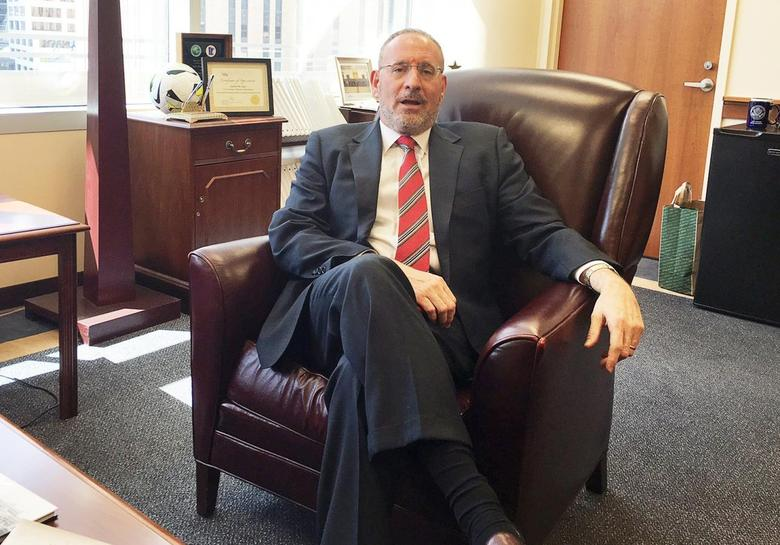 Attorney Andrew Luger, Minnesota's senior prosecutor, who is spearheading efforts to prevent youth in Minneapolis from joining ISIS, is pictured in his office in Minneapolis, Minnesota, U.S. April 15, 2016.   REUTERS/Julia Edwards