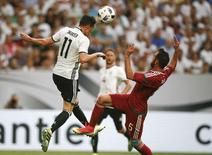 Football Soccer - EURO 2016 - International friendly - Germany v Hungary - Gelsenkirchen, Germany - 04/6/16    Germany's Julian Draxler and Hungary's Attila Fiola. REUTERS/ Wofgang Rattay
