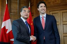 Canada's Prime Minister Justin Trudeau (R) meets with China's Foreign Minister Wang Yi during in Trudeau's office on Parliament Hill in Ottawa, Ontario, Canada, June 1, 2016. REUTERS/Chris Wattie