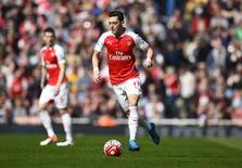 Football Soccer - Arsenal v Watford - Barclays Premier League - Emirates Stadium - 2/4/16 Arsenal's Mesut Ozil in action Reuters / Dylan Martinez Livepic