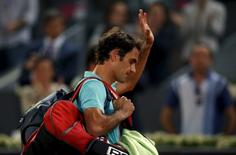 Roger Federer of Switzerland leaves the court after his defeat by Nick Kyrgios of Australia at the end of their match at the Madrid Open tennis tournament in Madrid, Spain, May 6, 2015. REUTERS/Susana Vera
