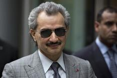 Prince Alwaleed bin Talal is seen leaving the High Court in London in this July 2, 2013 file photograph. REUTERS/Neil Hall