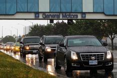 A line up of cars is seen on a road after a shift change at the General Motors Car assembly plant in Oshawa, June 1, 2012.  REUTERS/Mark Blinch