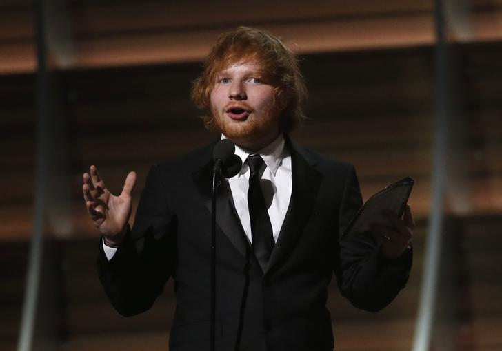 Ed Sheeran accepts the award for Song of the Year for ''Thinking Out Loud'' at the 58th Grammy Awards in Los Angeles, California February 15, 2016.  REUTERS/Mario Anzuoni