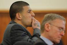 Former New England Patriots football player Aaron Hernandez (L) and his attorney Charles Rankin listen as prosecution witness Alexander Bradley is questioned by the prosecution without the jury present at Bristol County Superior Court in Fall River, Massachusetts April 1, 2015. REUTERS/Brian Snyder