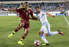 Venezuela forward Jose Salomon Rondon (9) and Uruguay midfielder Alvaro Gonzalez (20) compete for the ball during the second half of a group play stage of the 2016 Copa America Centenario at Lincoln Financial Field.  Mandatory Credit: Bill Streicher-USA TODAY Sports