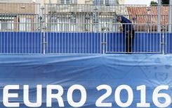A worker installs safety barriers at a fan zone before the start of the UEFA 2016 European Championship in Marseille, France, June 1, 2016.  REUTERS/Jean-Paul Pelissier