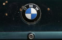 A BMW logo is pictured on a car's back at a scrapyard in Fuerstenfeldbruck, Germany, May 21, 2016.    REUTERS/Michaela Rehle