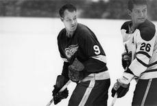 Detroit Red Wings' Gordie Howe in action against the Toronto Maple Leafs' Allan Stanley.  Detroit Red Wings/Handout via REUTERS