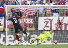 United States midfielder Clint Dempsey (8) scores past Paraguay goalkeeper Justo Villar (1) during the first half of the group play stage of the 2016 Copa America Centenario. at Lincoln Financial Field. Mandatory Credit: Bill Streicher-USA TODAY Sports
