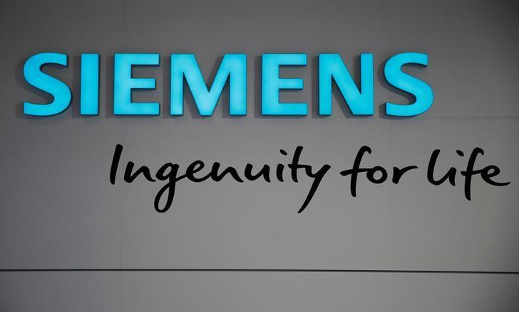 The logo of Germany's largest engineering company Siemens is pictured with the company's slogan ''ingenuity for life'' during the Hannover Fair in Hanover, Germany, April 25, 2016.    REUTERS/Wolfgang Rattay