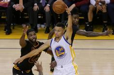 Golden State Warriors guard Stephen Curry (30) controls the ball against Cleveland Cavaliers center Tristan Thompson (13) and guard Iman Shumpert (4) during the second half in game five of the NBA Finals at Oracle Arena. Mandatory Credit: Kelley L Cox-USA TODAY Sports