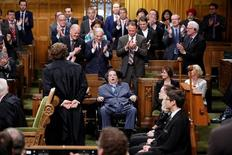 Liberal MP Mauril Belanger (C) receives a standing ovation while voting on his private member's bill to change the national anthem in the House of Commons on Parliament Hill in Ottawa, Ontario, Canada, June 15, 2016. REUTERS/Chris Wattie