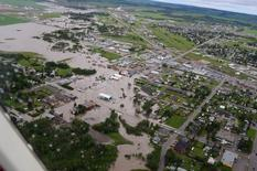 An aerial photo shows flooding in the City of Dawson Creek after heavy rain in this image posted on social media in British Columbia, Canada on June 16, 2016.  Courtesy City of Dawson Creek/Handout