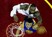 Cleveland Cavaliers forward LeBron James (23) blocks a shot by Golden State Warriors guard Stephen Curry (30) in game six of the NBA Finals at Quicken Loans Arena. Mandatory Credit: Mandatory Credit: Ron Schwane/Pool Photo via USA TODAY Sports