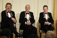 Led Zeppelin band mates (L-R) Robert Plant, Jimmy Page and John Paul Jones sit as U.S. President Barack Obama (not pictured) hosts an event for the 2012 Kennedy Center honorees in the East Room of the White House in Washington, December 2, 2012.     REUTERS/Jason Reed