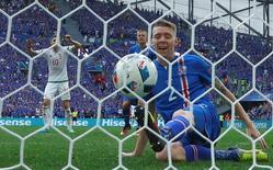 Football Soccer - Iceland v Hungary - EURO 2016 - Group F - Stade Velodrome  - Marseille, France - 18/6/16 Iceland's Birkir Saevarsson scores an own goal    REUTERS/Eddie Keogh