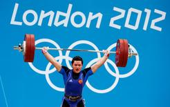 Russia's Natalya Zabolotnaya lifts on the women's 75Kg group A weightlifting competition at the ExCel venue at the London 2012 Olympic Games August 3, 2012.                REUTERS/Dominic Ebenbichler
