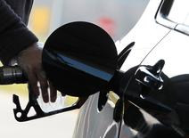 A driver pumps petrol into his car at a petrol station in Brussels March 8, 2011. REUTERS/Yves Herman