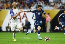 Jun 21, 2016; Houston, TX, USA; Argentina midfielder Lionel Messi (10) advances the ball as United States midfielder Michael Bradley (4) defends during the first half in the semifinals of the 2016 Copa America Centenario soccer tournament at NRG Stadium. Troy Taormina-USA TODAY Sports