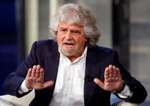 Leader of the Five Star Movement and comedian Beppe Grillo gestures as he appears as a guest on the RAI television show Porta a Porta (Door to Door) in Rome, May 19, 2014.   REUTERS/Remo Casilli/File Photo