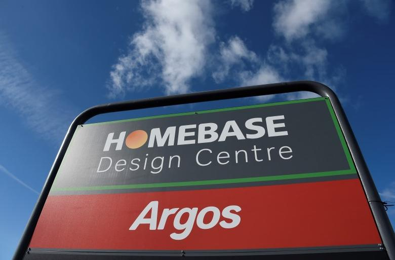 Signage For Sainsburys Homebase And Argos Is Seen Outside Of One Their Branches In London