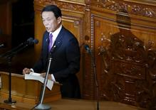 Japan's Finance Minister Taro Aso speaks during the lower house session of the parliament in Tokyo, Japan, January 4, 2016. REUTERS/Toru Hanai/File Photo