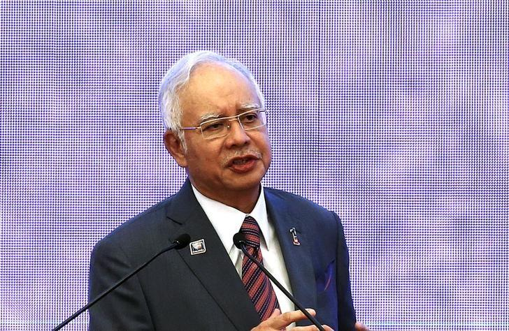 Malaysia's Prime Minister Najib Razak speaks at the 48th Association of Southeast Asian Nations (ASEAN) foreign ministers meeting in Kuala Lumpur, Malaysia, August 4, 2015.  REUTERS/Olivia Harris/File Photo