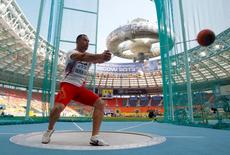 Koji Murofushi of Japan competes in the men's hammer throw qualifying round during the IAAF World Athletics Championships at the Luzhniki stadium in Moscow August 10, 2013.  REUTERS/Dominic Ebenbichler