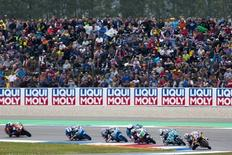 KTM Moto3 rider Miguel Olivera of Portugal (R) leads the pack during the race at the TT Assen Grand Prix at Assen, Netherlands June 27, 2015. REUTERS/Ronald Fleurbaaij