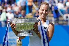Britain Tennis - Aegon International - Devonshire Park, Eastbourne - 25/6/16 Slovakia's Dominika Cibulkova celebrates victory with the trophy Action Images via Reuters / Peter Cziborra Livepic