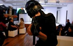 Models pose in bulletproof clothing and equipment by the Miguel Caballero Factory at the Chico Museum in Bogota, Colombia, June 24, 2016. REUTERS/John Vizcaino
