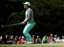 Jun 12, 2016; Sammamish, WA, USA; Lydia Ko reacts after missing a putt on the 13th hole during the final round of the KPMG Women's PGA Championship at Sahalee Country Club - South/North Course. Mandatory Credit: Kelvin Kuo-USA TODAY Sports