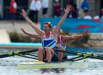 Britain's Katherine Grainger (front) and Anna Watkins celebrate after winning the women's double sculls rowing final during the London 2012 Olympic Games at Eton Dorney August 3, 2012.    REUTERS/Francisco Leong/Pool