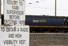 A Pacific National goods train, owned by Asciano Group Ltd, sits idle at a rail goods yard in Melbourne August 26, 2009. REUTERS/Mick Tsikas