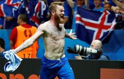 Iceland's Aron Gunnarsson celebrates after the game. REUTERS/Michael Dalder